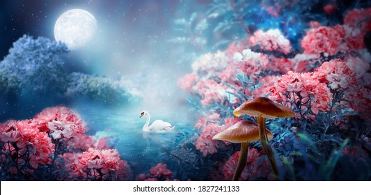 Fantasy magical enchanted fairy tale landscape with swan swimming in lake, fabulous fairytale blooming pink rose flower garden and mushrooms on mysterious blue background and glowing moon ray in night