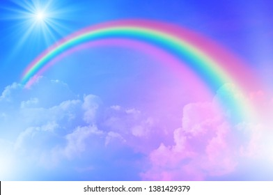 Fantasy magical landscape rainbow on sky abstract big volume texture fluffy clouds shine close up view straight. cotton wool. pink purple pastel colors sun fabulous background