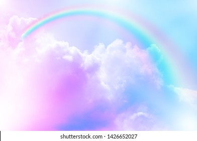 fantasy magical landscape rainbow on sky abstract big volume texture fluffy clouds shine close up view straight, cotton wool, pink purple pastel colors sun fabulous background
