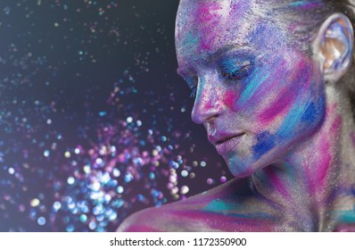 Fantasy makeup. Woman with colorful makeup and body art against dark background with sequins. Fashion