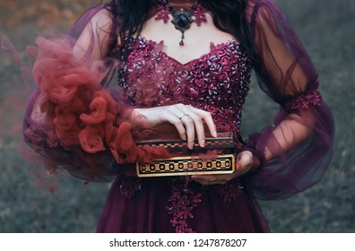 fantasy mysterious woman silhouette legend of Pandora's box, black hair purple luxurious dress, antique vintage gold casket open produces red smoke outside diseases curses. art artwork Pandora goddess