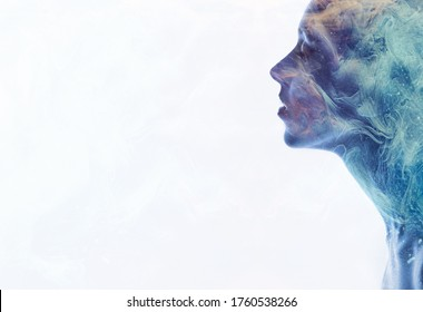 Fantasy portrait. Universe energy. Purple blue smoke in relaxed woman silhouette double exposition isolated on white.