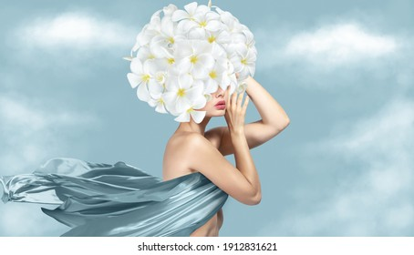 Fantasy portrait of young beautiful woman with blue silk cloth and flowers