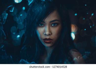 Fantasy portrait of young woman at night rain