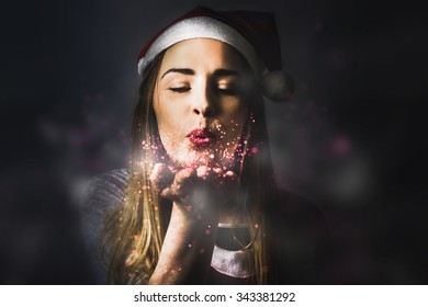 Fantasy style photo of a pretty blonde female elf making dreams come true when sharing the magic of christmas