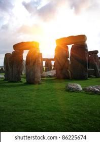 Fantasy sunrise at Stonehenge with dramatic sky and sun rays