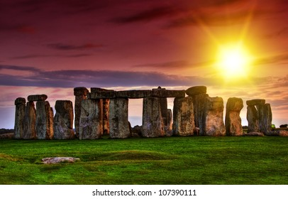 Fantasy sunset at Stonehenge with dramatic sky and sun rays