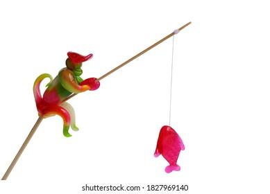 Fantasy sweet candy, Delicious Fishing monkey shaped on white background.