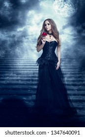 Fantasy Woman in Black Dress Smelling Rose Flower, Mystic Girl in Long Retro Gothic Gown