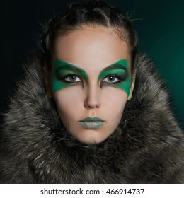 fantasy woman in fur and green make-up.fairy beautiful girl.barbarian who lives in the woods