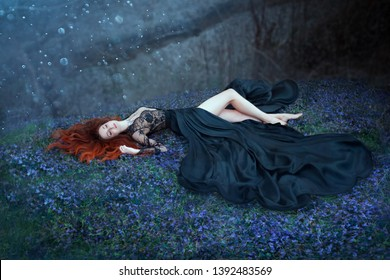 fantasy woman red hair lying sleep dream. grass flowering meadow dark forest. queen vampire medieval lady. long in black dress lace open chest, sexy hot nymph sexy bare legs. moon light night magic