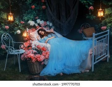 fantasy woman sleeping beauty lies sleep on comfortable bed, mattress, soft pillow. Background mystical garden, night, peonies flowers green trees. Fairy-tale girl princess in blue dress. Sweet dreams - Shutterstock ID 1997770703