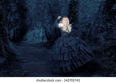 Fantasy woman traveling at night with a lantern