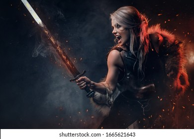 Fantasy woman warrior wearing cuirass and fur, holding a sword scabbard ready for a battle. Fantasy fashion.