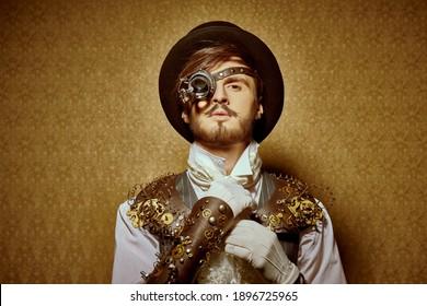 Fantasy world. Portrait of a handsome steampunk man on a vintage background.