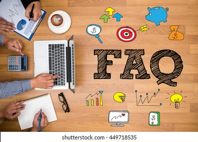 FAQ abbreviation ( frequently asked questions ) Business team hands at work with financial reports and a laptop