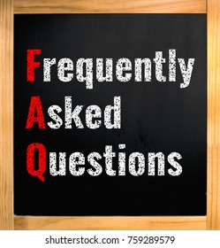 FAQ - frequently asked questions, chalk text on black board with wooden frame