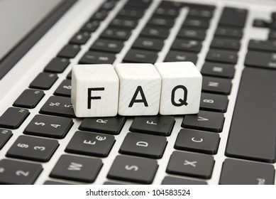 FAQ frequently asked questions sign symbol an a laptop keyboard