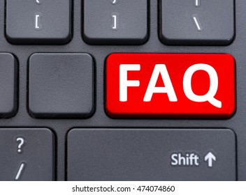 Faq red button on black keyboard as frequently ask question concept