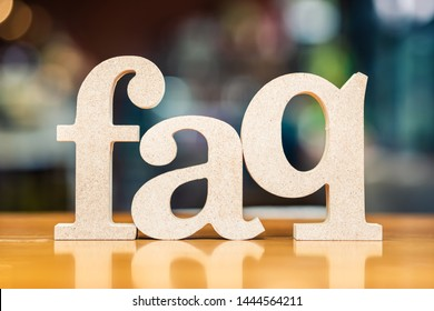 FAQ wood alphabet set on the table as the acronym of Frequently Asked Question, shallow depth of field to blur background