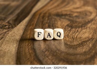 FAQ word background on wood blocks