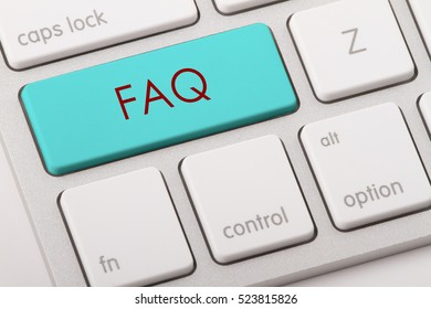 FAQ word written on computer keyboard.