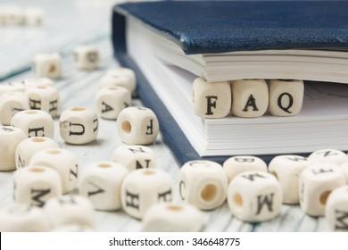 FAQ word written on wood block