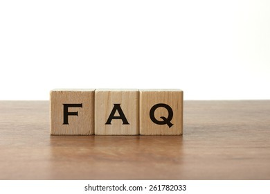 FAQ Written On Wood Blocks