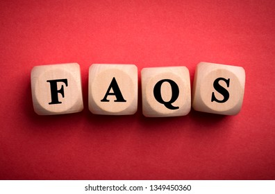 FAQS wooden blocks isolated on color background.