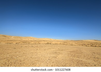 Far hills in Negev Desert under blue sky