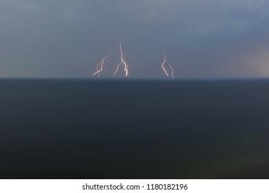 Far lightning strikes in the sea