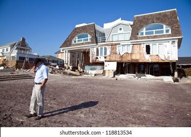 FAR ROCKAWAY, NY - NOVEMBER 11: Insurance company adjuster examining damage  in the aftermath of Hurricane Sandy on November 11, 2012 in Far Rockaway, NY