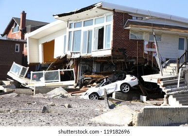 FAR ROCKAWAY, NY - NOVEMBER 11: Destroyed beach houses in the aftermath of Hurricane Sandy on November 11, 2012 in Far Rockaway, NY