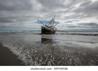 FAR ROCKAWAY, QUEENS, NY/USA - FEBRUARY 25, 2016: The scallop fishing vessel Carolina Queen III rests in heavy surf in the Atlantic ocean off Far Rockaway in the borough of Queens in New York City.