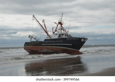 FAR ROCKAWAY, QUEENS, NY/USA- FEBRUARY 25, 2016: The scallop fishing vessel Carolina Queen III rests in heavy surf in the Atlantic ocean off Far Rockaway in the borough of Queens in New York City.