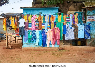 FARAFENNI/GAMBIA - NOVEMBER 18, 2013: Colorful clothing for sale on the street of a small african town