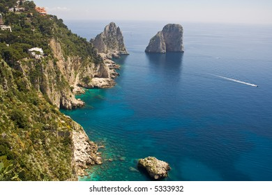 "The ""Faraglioni"" in Capri (famous seaside rock formations). View of the coastline of the island of Capri, Amalfi Coast, Italy"
