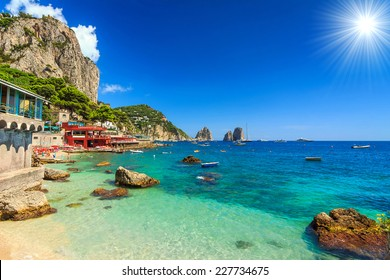 Faraglioni cliffs and wonderful beach in Capri island,Italy,Europe