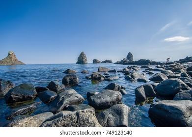 """""""Faraglioni"""" the famous cyclops island in Acitrezza, Sicily"""