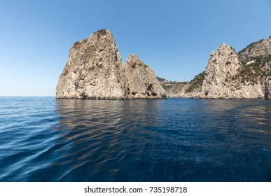 Faraglioni Rocks on Capri Island, Italy. Rock's names left to left: Stella, Mezzo and Scopolo or Fuori