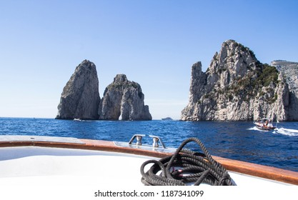 Faraglioni rocks view from boat in Capri, Italy