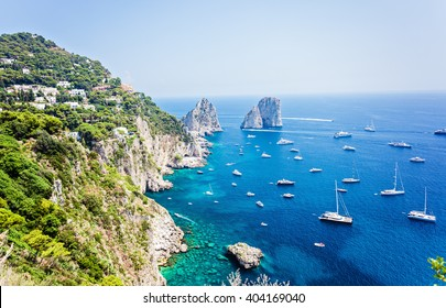 Faraglioni rocks visible from Giardini di Augusto in Capri, Italy. Focus on stone rocks