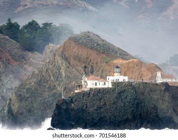 Farallon Islands lighthouse  off coast of San Francisco in the Gulf of Farallon on a sunny, clear day