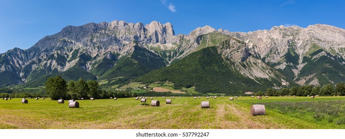 The Faraut mountain with Roc Roux, Tete de Claudel and Tete du Collier on a summer afternoon near Chauffayer. Hautes Alpes, Southern French Alps, France