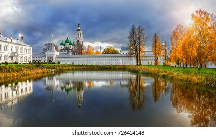 Farewell beauty of autumn. Tolga Monastery in Yaroslavl with reflection in a pond and golden autumn trees