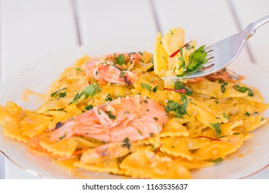 Farfalle pasta with shirimps, saffron and lemon zest.