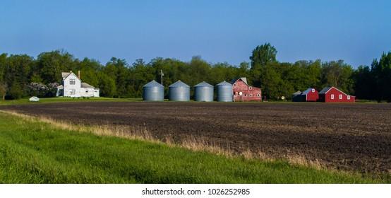 A farm with barn, grain storage bins and a farm house in North easter North Dakota.