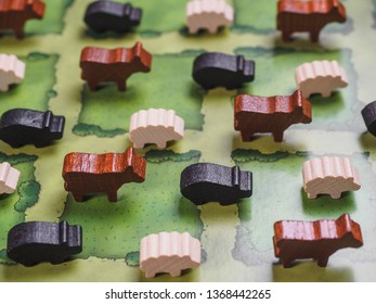 Farm board game with fields figures and animals.
