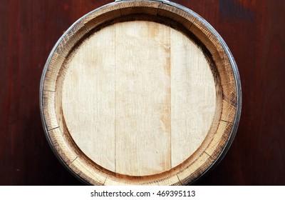 Farm concept. Closeup of oak barrel top. Nice wooden background