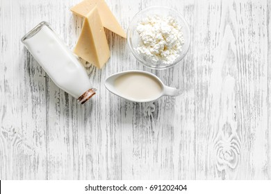Farm dairy products. Milk, cottage, cheese on light wooden background top view copyspace